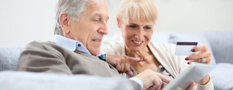 Senior couple e-shopping with digital tablet