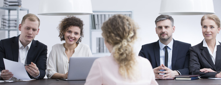 Businesswoman discussing resume with recruiters